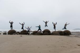 Boys having fun at the Moeraki Boulders